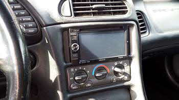 "1999 Corvette. Custom fit a double din into the dash for a Kenwood 6.1"" Monitor/DVD Receiver."