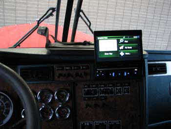 2005 Kenworth Semi - Installed a Clarion single din flip out with bluetooth/ USB / Navigation / DVD / Satilite Radio / , a 2000 watt power converter and installed a flat screen TV and a micro wave and a Fridge.