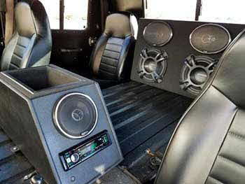 "Hummer H1 (military model). Built a small basic center console to house Kenwood digital media receiver, a pair of 5.25"" coax speakers and an amplifier with a storage area. Also custom built a subwoofer enclosure for 2 each 10"" subs and a pair of 6X9 speakers. Center console was bed lined to match the interior."