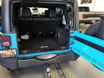 "2017 Jeep Wrangler in for a custom made enclosure for a Kenwood 10"" slim mount subwoofer."