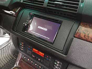 "2004 BMW X5. This model had an OEM navigation indash and there is no aftermarket kit so we fabricated our own kit to house a Kenwood 6.2"" entertainment receiver."