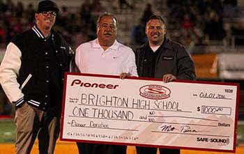 with Pioneer at Brighton High School where we donated 1000.00 to their Football and dance program.