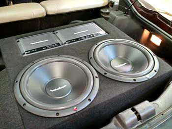 "95 Mitsubish 3000GT - Installed system with basic custom subwoofer enclosure that incorporated the amps. Kenwood receiver, Focal 5 1/4"" speakers up front, Kenwood 6x9's in the rear. Rockford 12"" subs, 2 Rockford amps."