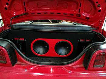 95 Ford Mustang. Insalled Pioneer Entertainment System, Kenwood speakers, Rockford Fosgate amps and Rockford subs. Built custom enclosure with amps trimmed in with red LED's.