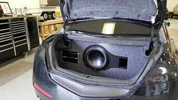 2009 Acura TL before and after photos of pre-fab box in the trunk. We custom built a bass enclosure to fit the trunk to house a Rockford sub and the mono amp.