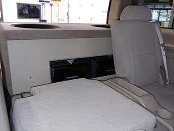 "2007 Chevy Suburban. Installed Kenwood entertainment system, Rockford components up front and in the rear. Custom built huge 10 cubic foot enclosure that housed Rockford amps, and four 15"" woofers with Rockford amps housed in the enclosure. Also installed Viper alarm remote start. This baby shook the ground!"