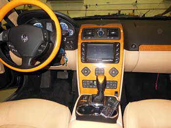 "2007 Maserati. Replaced the Maserati factory head unit with Kenwood components: factory integration unit, 7"" touchscreen indash monitor, add on navigation & blue tooth, CD/DVD player and custom built the dash unit & a custom built trunk enclosure. Also installed a Crimestopper back-up camera."