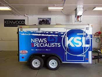 KSL Trailer: Completely carpeted interior. Built custom cabinet for electronics, built storage bench & custom enclosure for subwoofer. Wired entire interior for TV's & sound system. Cut in water resistant plates on outside for speaker terminals.