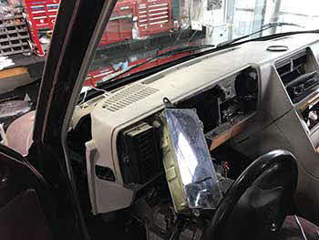 1990 Custom Van with dash removal for speaker installation.