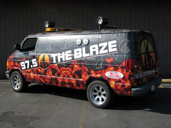 97.5 - The Blaze.  JVC I-Pod Direct Connect Receiver, Diamond Power Amplifiers, Rockford Fosgate Spakers, Bazooka Wakeboard Tower, Marine Speakers Mounted on the Roof, Clarion Marine Speakers on the Outside of the Van's Body.