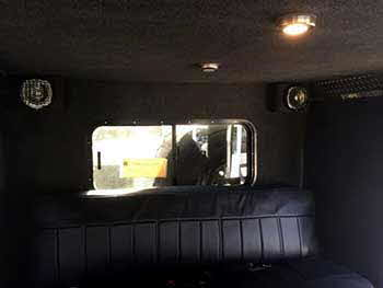 Military style Hummer. Installed a Kenwood receiver with Kenwood front & rear camera. Rockford Fosgate front & rear speakers, pair of Rockford tower speakers and a Rockford slim mount subwoofer under bench seat. Custom built enclosure for a 24 volt amp.