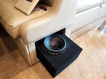 "Converted a drawer under the table bench seat into a Rockford Fosgate P2 Series 10"" subwoofer location. Made a new face/grill for the sound to pass through.  Installed TV's with Kenwood Excelon 7"" 2-way speakers, pair of Kenwood 5.25"" speakers and 2 Kenwood amplifiers."