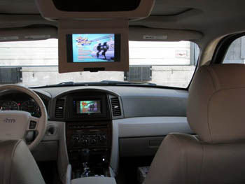 "2006 Jeep Grand Cherokee - JVC Arsenal Multimedia with Navigation and Bluetooth, Integrated into Existing Factory Roof Mount Monitor, 15"" Rockford Fosgate Subwoofer and Bass Box."