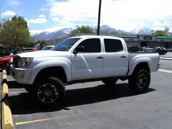 2006 Toyota Tacoma. Installed JVC AM/FM/CD/DVD Multimedia Entertainment System, 2 Rockford Fosgate Amplifiers, 2 ea. Clarion Slim Mount Woofers in a Custom Bass Enclosure. - Designed and installed by the Salt Lake City store.