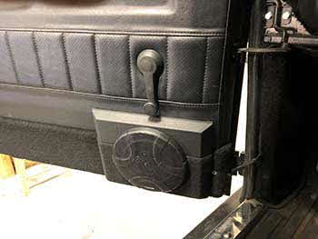 1990 Landrover Defender has no provision for an aftermarket radio so we installed a Kenwood receiver & Rockford amps into the center console. There's no depth in the doors for speakers so spacers were made and wrapped in vinyl & carpeted to match the doors for Pioneer speakers in the front & rear. Installed Hertz speakers into the dash. Custom made sealed enclosure for 2 Kenwood subs. Sounds and looks great!