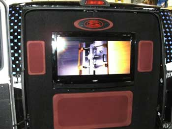 "104.7 Radio Van - Installed JVC AM/FM/CD HD Radio - Rockford Fosgate Speakers - Rockford Fosgate 4-channel & mono amplifiers and custom amplifier rack - Cliff Designs Full Range Speakers - 2 each Planet Audio 12"" Subwoofers - Custom Installation/Integration of a 32"" TV."