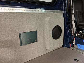 "2018 Mercedes Sprinter 2500. Installed a Kenwood navigation/entertainment system, Kenwood component speakers up front and Kenwood 6"" speakers in rear doors. Integrated OEM back up camera & steering wheel controls. Built custom stack fab subwoofer enclosure that comes out of the wall and flushed a 5 channel amp next to it. The box was trimmed with matching wall panel material and affixed to the vehicle with threaded nutcerts."