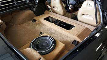 1999 C5 Corvette. Custom molded to fit a Pioneer entertainment system into dash. Custom built amp and subwoofer enclosures to allow for the T-top to still be stowed in cargo area. Installed Rockford components in front doors and Rockford coax in the rear plus installed a back-up camera.