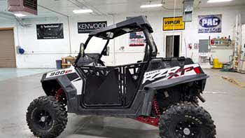 "Polaris RZR900. Installed Kenwood bluetooth 4-channel power amp, Kenwood 6.5"" marine 2-way speakers, SSV Works dual overhead 6"" roof pod # front kick panels."