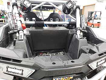 "2017 Polaris RZR Turbo. We custom built a downfire vented enclosure for the cargo area. It's 100% 1"" thick plastic (no wood) and is bed lined and mounted to the RZR. It has a custom grill for the vent pass through to the back seat. RZR already has a Rockford Fosgate Stage 5 kit. This upgrade gave the RZR a nice rich deep bass."