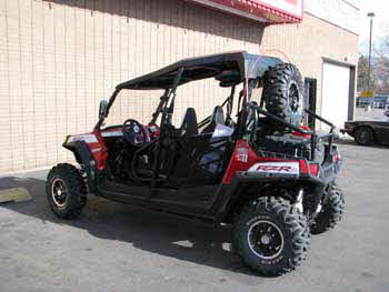 2010 Polaris Razor. It Has a pair of Boss tower speakers mounted on the roll bar and a Clarion Digital Marine Display Head Unit with a Water Tight Hideaway Command Source