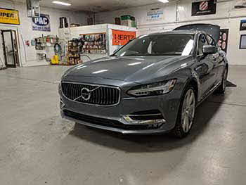 2017 Volvo S90. We custom built an enclosure to house a Kenwood Excelon 10� sub keeping the trunk functional and OEM looking. Also installed an Audio Control output converter and an Rockford Fosgate amplifier.